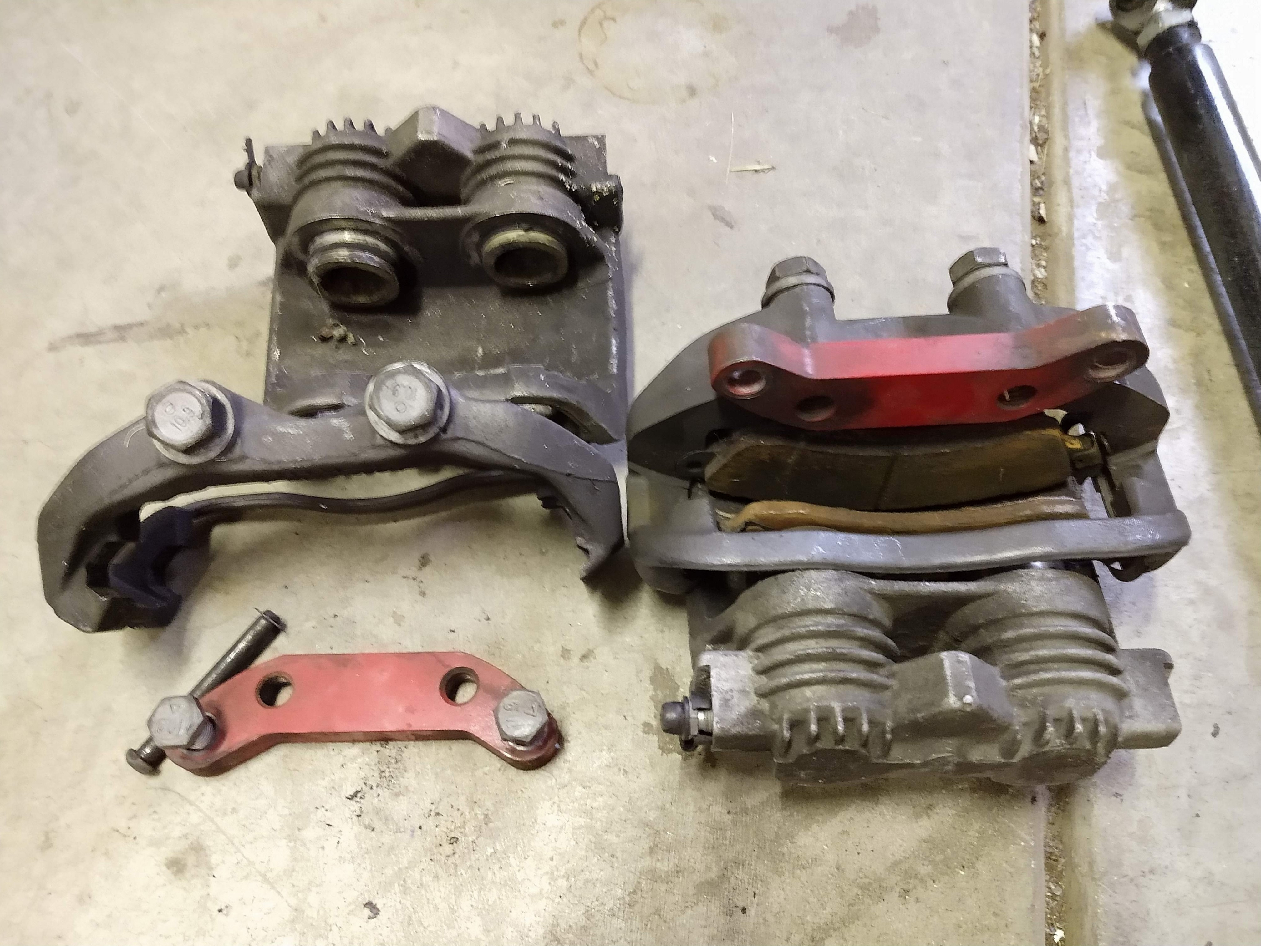 Calipers with cages and adaptor brackets. All genuine GM.